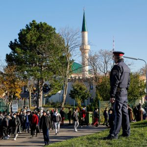 A police officer stands outside the mosque after the Friday prayer, in Vienna, Austria November 6, 2020.